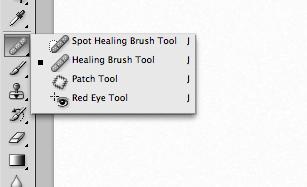 點選左邊工具列的修復筆刷工具 (Healing Brush Tool)!